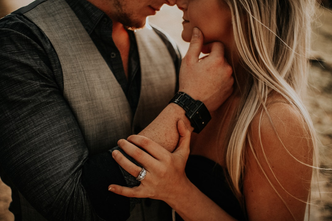 selective focus photography of woman and man about to kiss