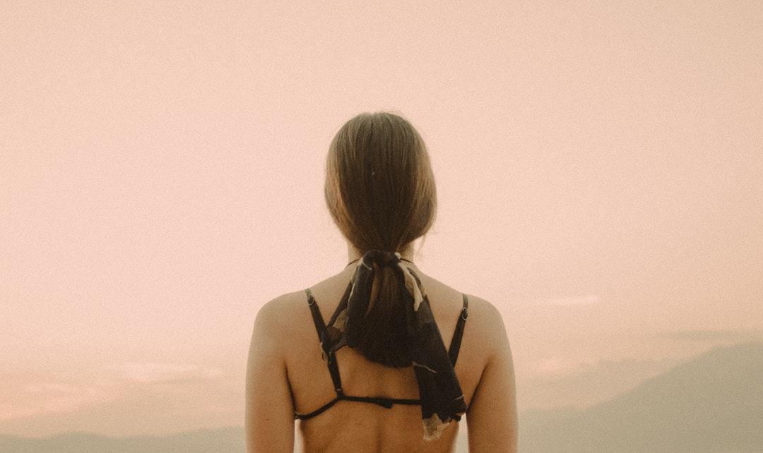 woman wearing black bra at daytime