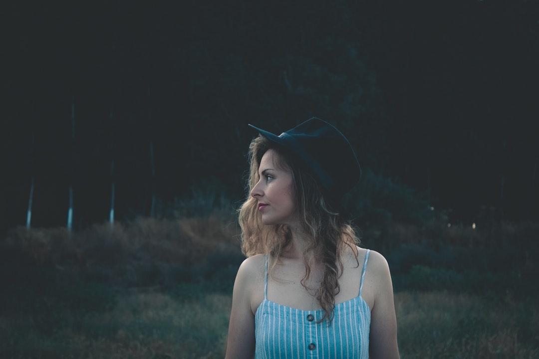 woman wearing cap standing on field