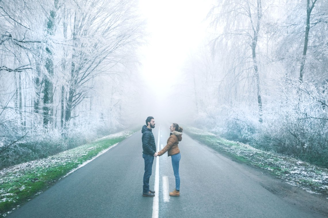 couple standing in an empty road