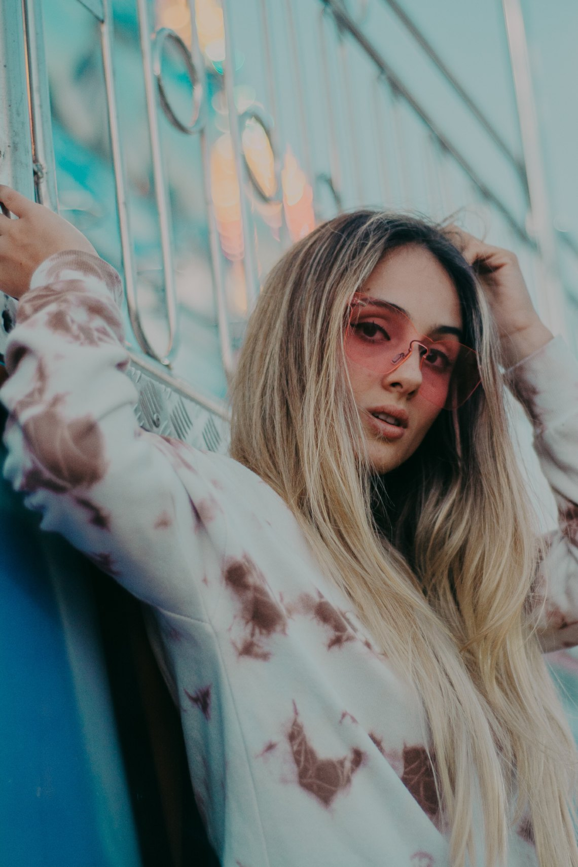 girl in a sweatshirt and sunglasses