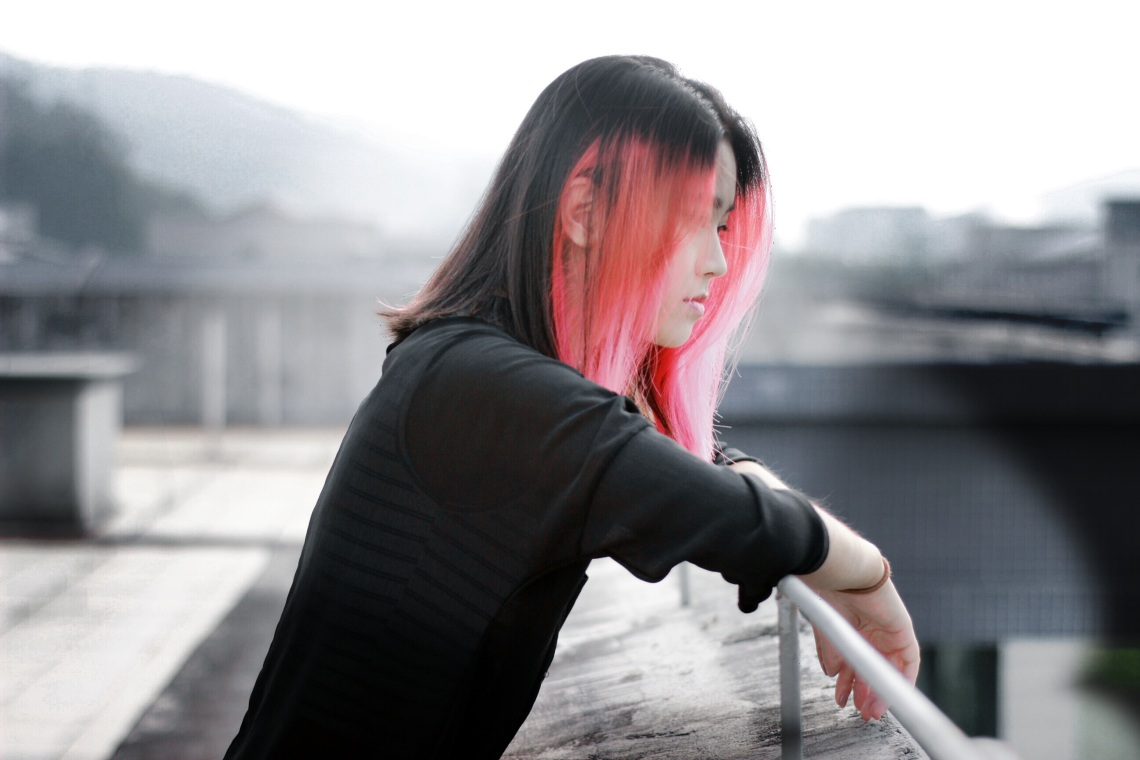 girl with pink hair on roofdeck