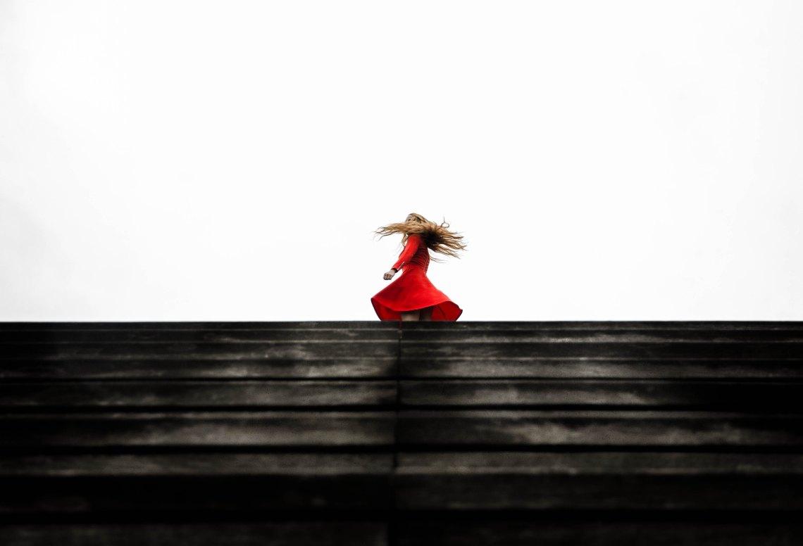 woman dancing in red dress