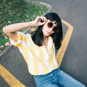a girl in a yellow striped shirt
