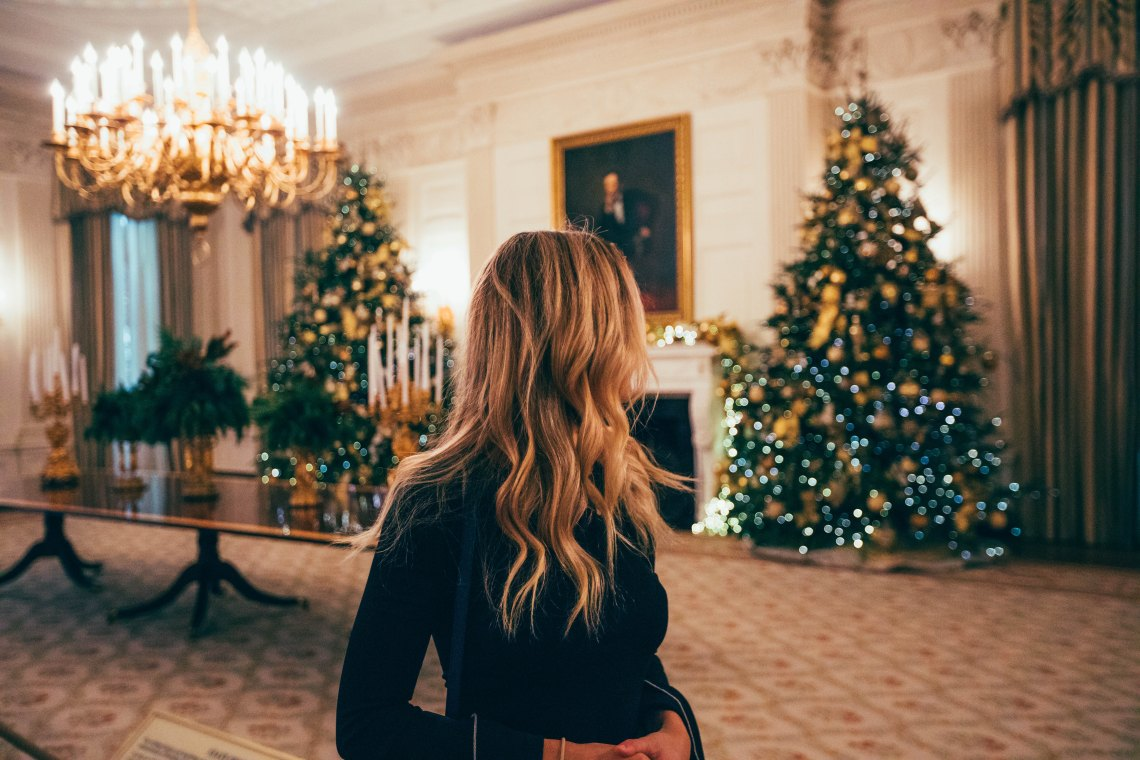 woman looking at christmas tree, holidays, holiday season, reminders, simple reminders, fight the holiday blues