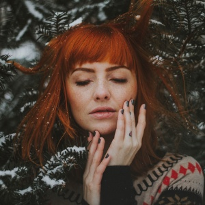 red head in a pine tree