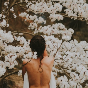 naked woman in a bunch of flowers