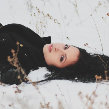 girl laying in the snow