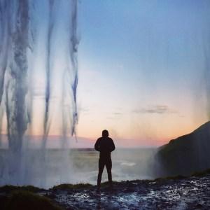 man next to a lake