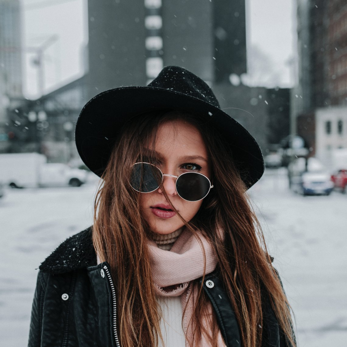 girl in the snow with sunglasses