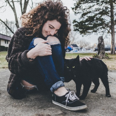 happy girl petting a cat, happy woman, self-love, self-love is a process, loving yourself, learning to love yourself