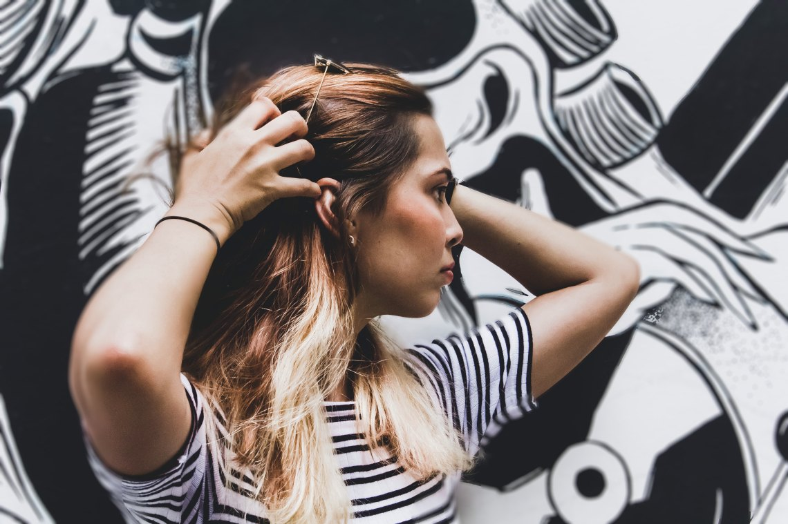 woman with hands in her hair, questions women should stop asking, feminism