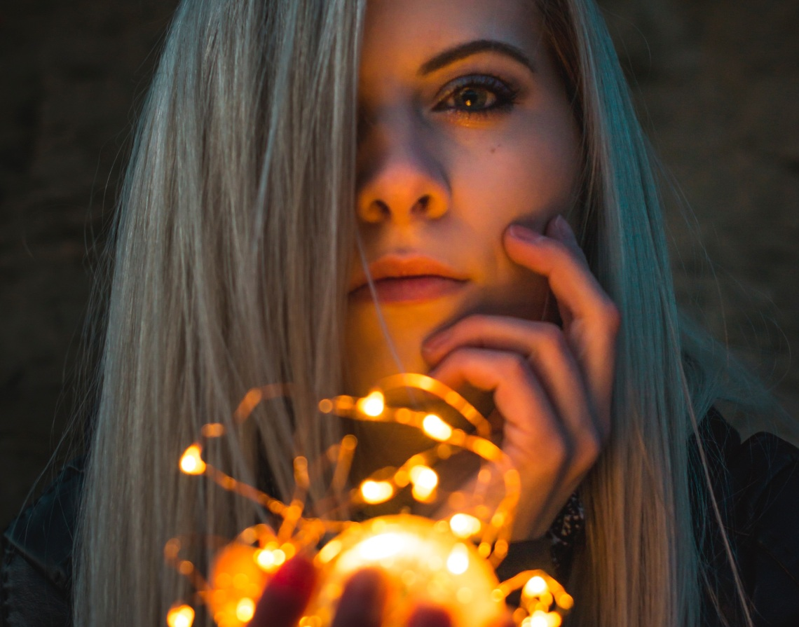 girl with lights, somber girl, heart burning with passion, passionate, new year