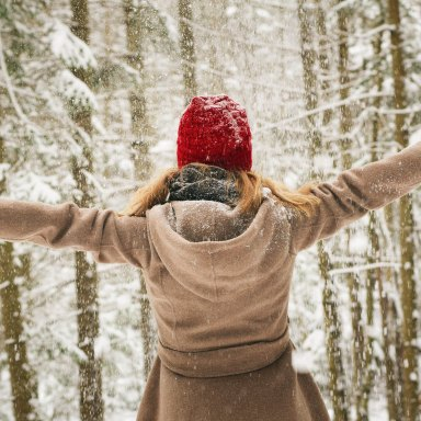 girl in the snow arms out