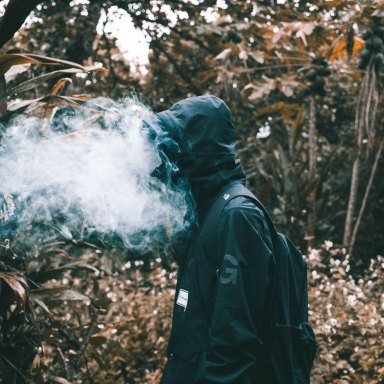 man with smoke all up in his face