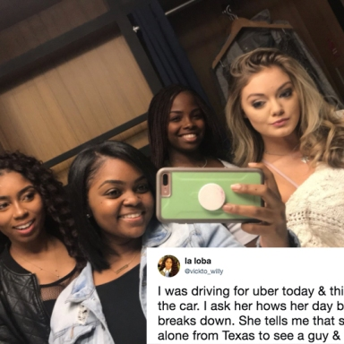 The girl and her uber driver and friends pose for a picture