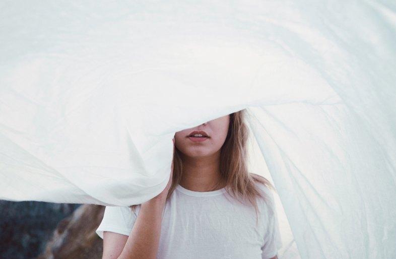 girl under a sheet
