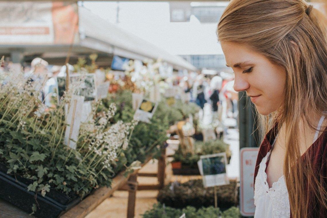 girl happy in a flower shop