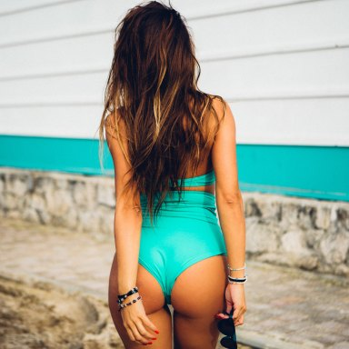 girl in a blue bikini with her perfect butt out