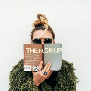 girl reading a fuck up book