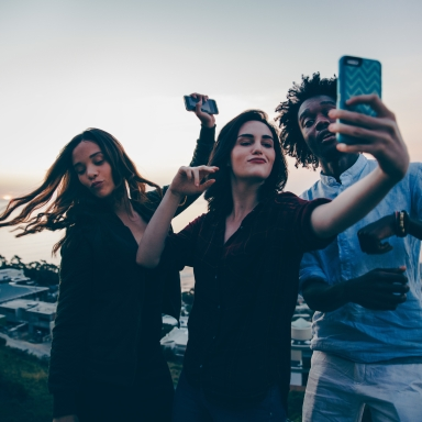group of friends taking seflie being silly