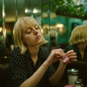 woman sitting in diner