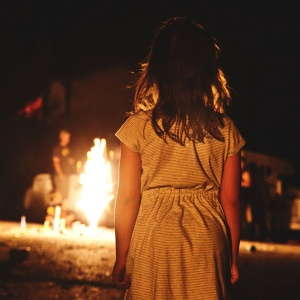 Little girl watches the fire burn, creepy, horror