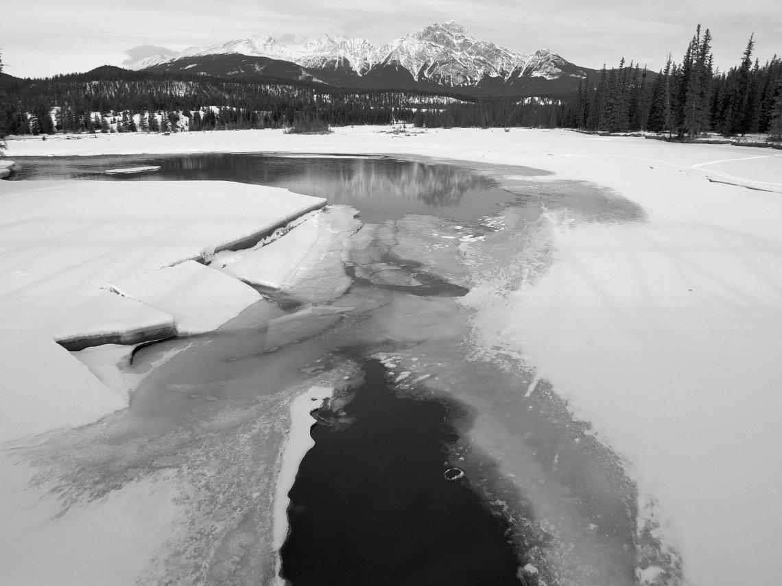 frozen lake black and white