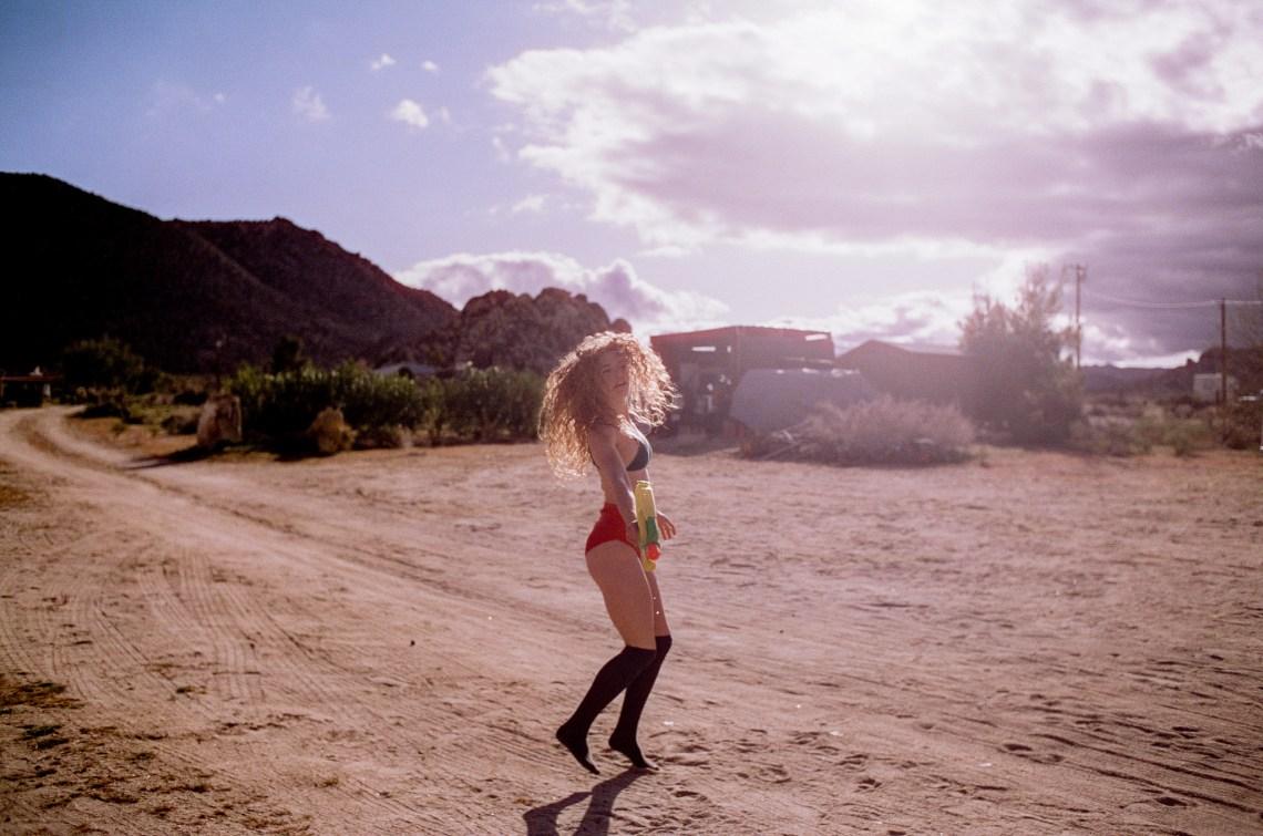 Girl playing in the desert