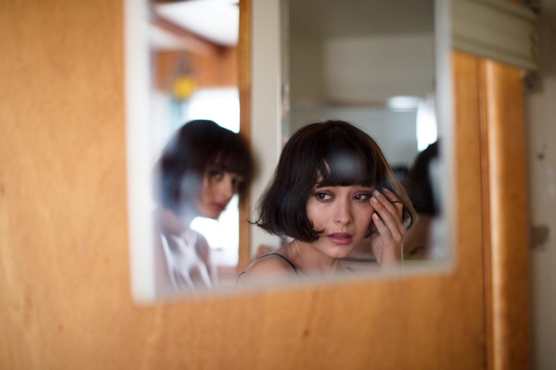 girl crying in mirror