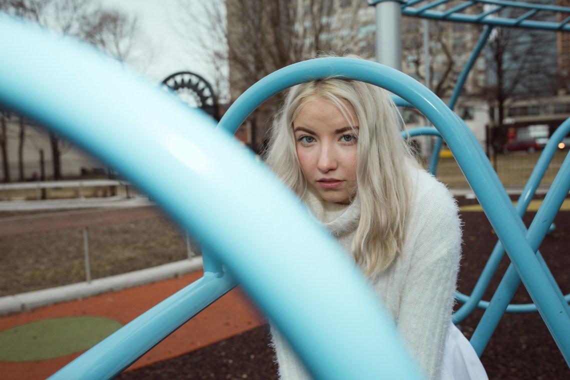 woman sitting on playground thinking