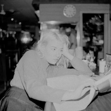 woman looking depressed reading newspaper