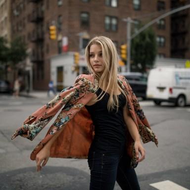 pretty woman crossing the street