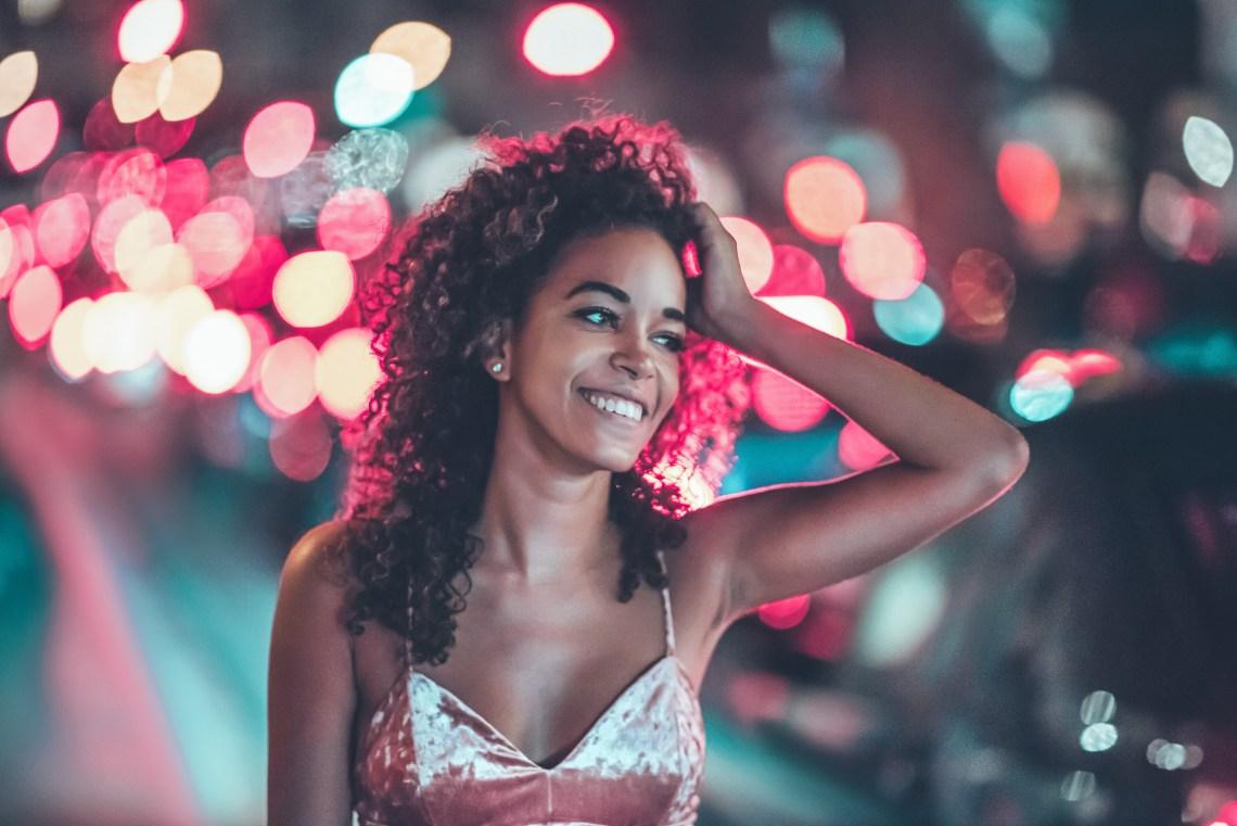 woman standing looking happy