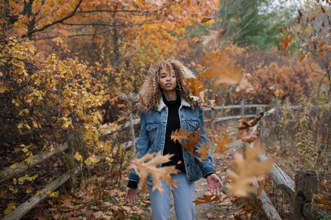 mysterious woman deems the falling leaves to stop