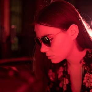 girl in sunglasses and a red light