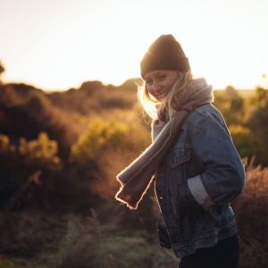 woman standing at sunset in chilly air