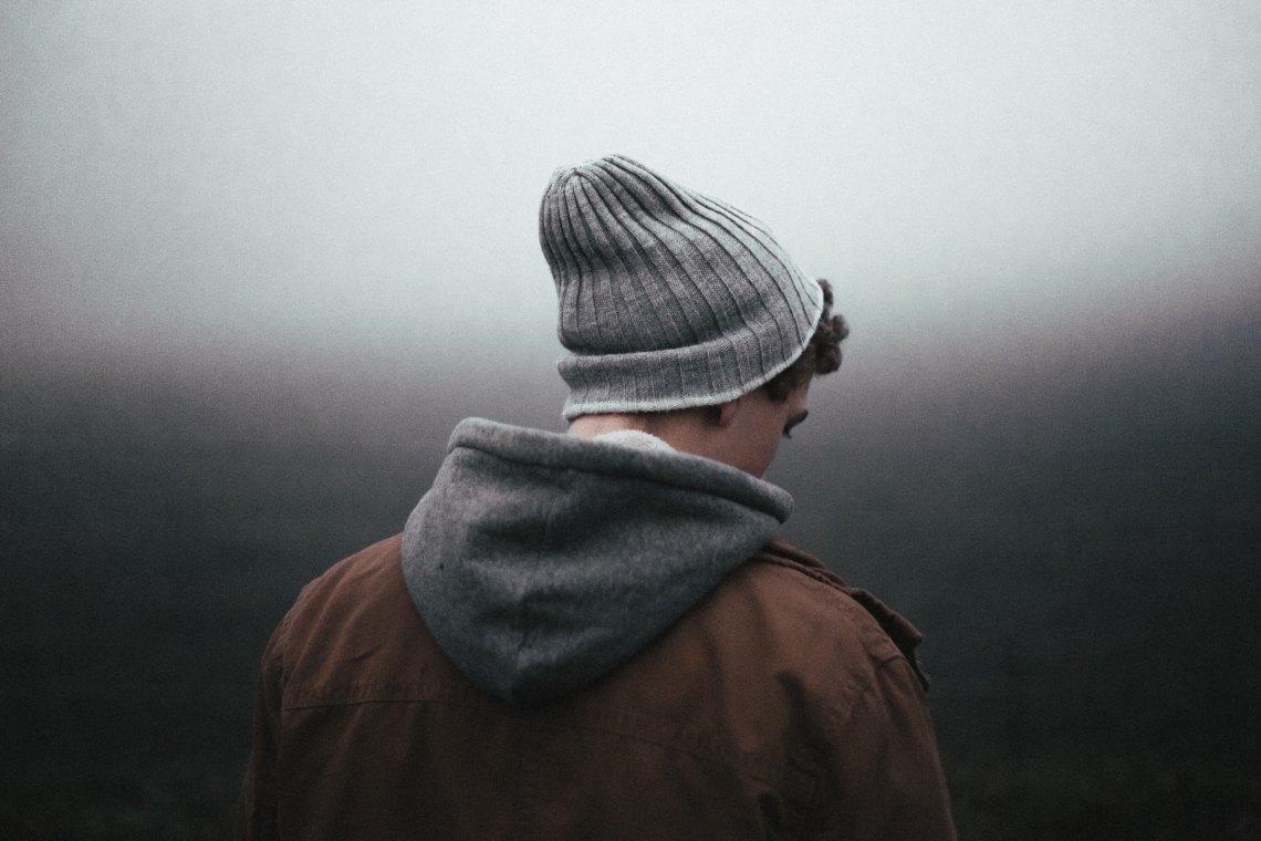 man standing looking sad