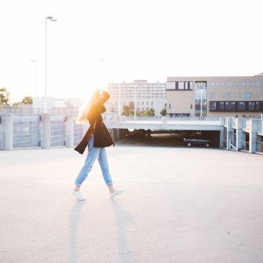 woman walking in parking lot