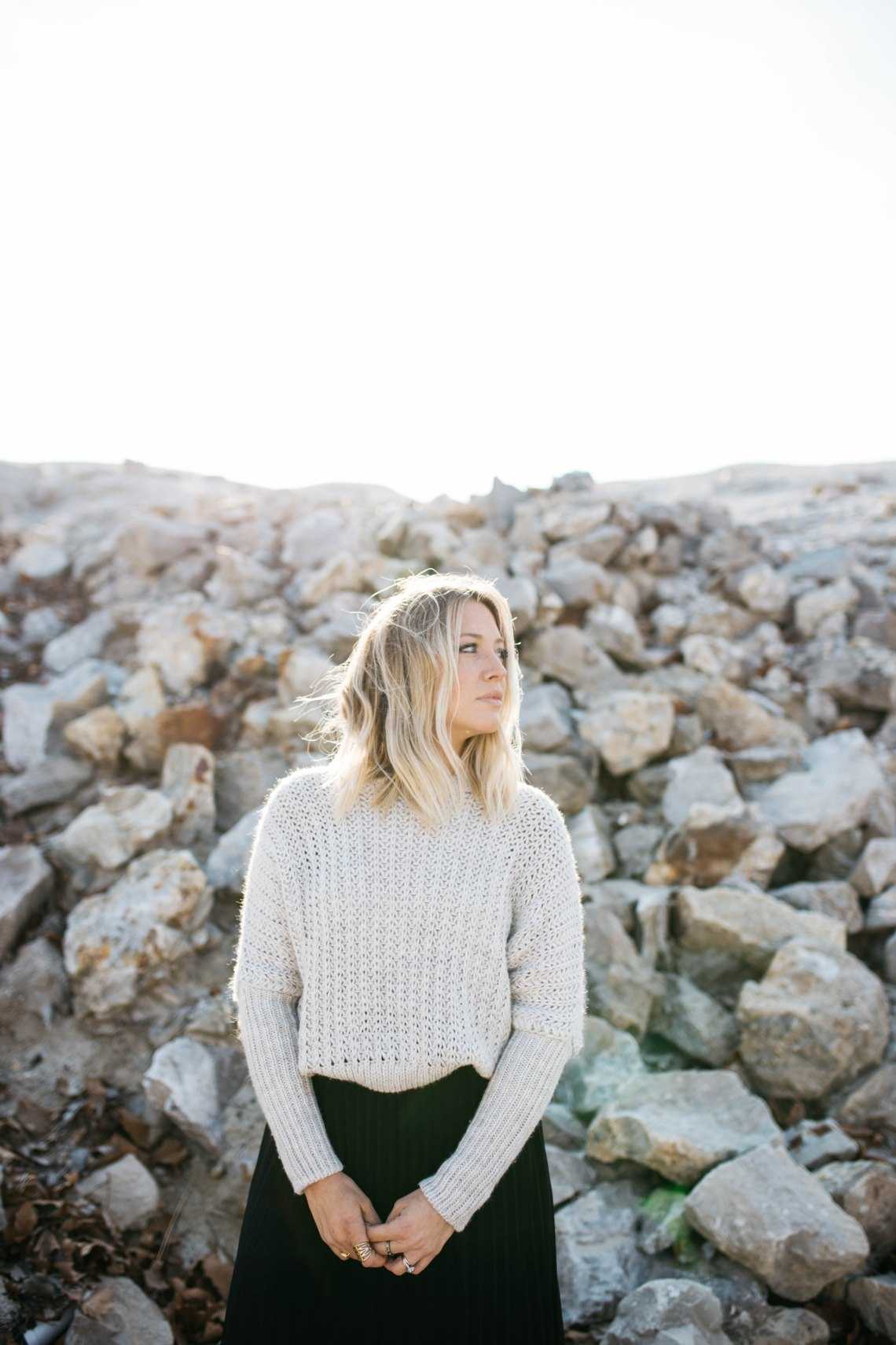 blonde girl by some rocks