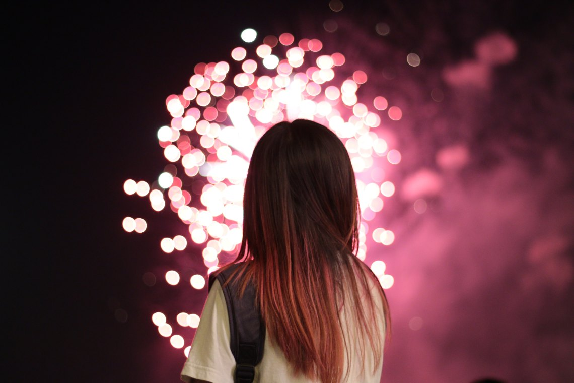 girl looking at fireworks