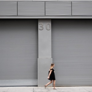 woman walking with 30 above her head