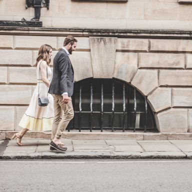 couple walking along street