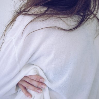 girl in a white sweater messy hair