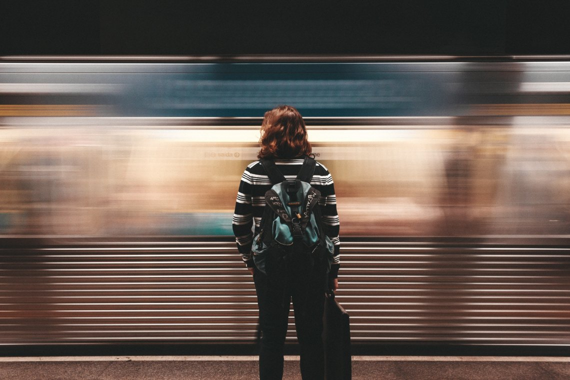 girl looking at train