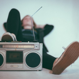 A girl listening to song lyrics