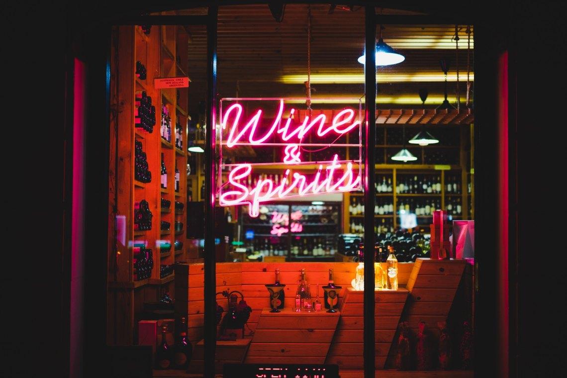 neon sign saying wine and spirits