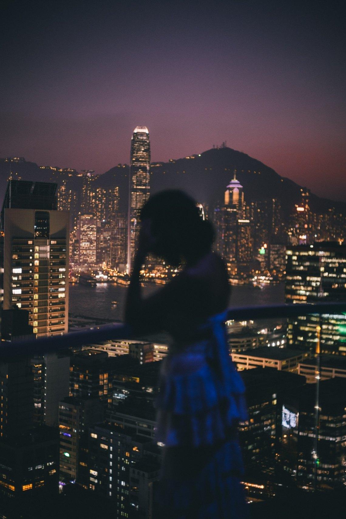 woman standing overlooking city