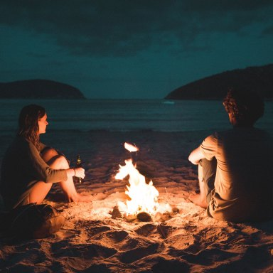 couple at a chill bonfire