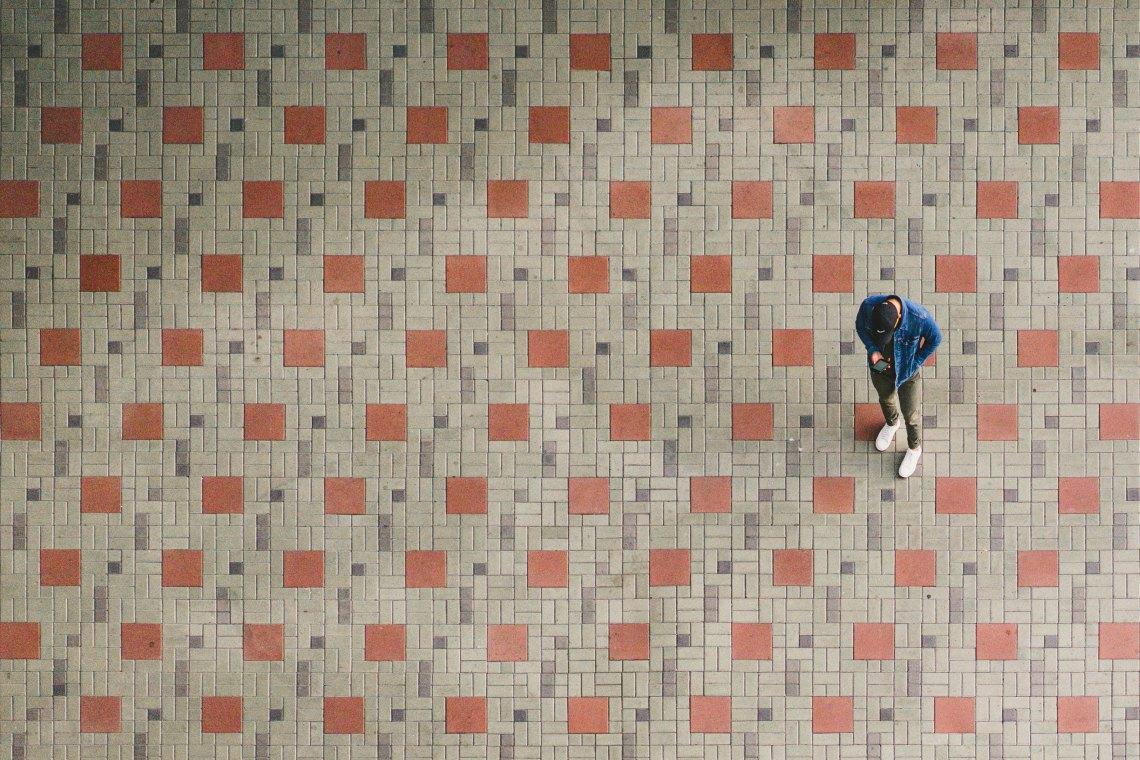 man standing on tiles